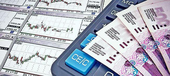 Калькулятор, деньги и графики котировок